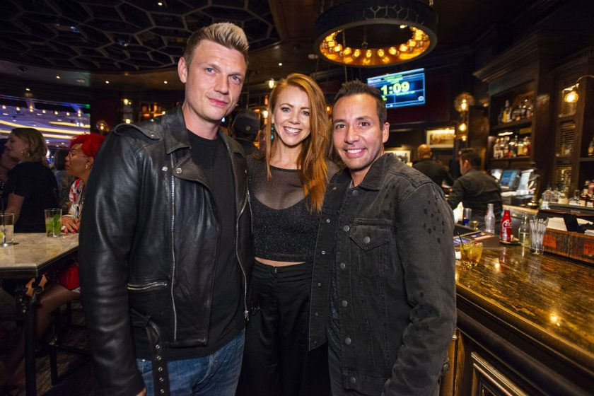 Lynn Gilmartin with Nick Carter and Howie Dorough of the Backstreet Boys at Tiger's Poker Night