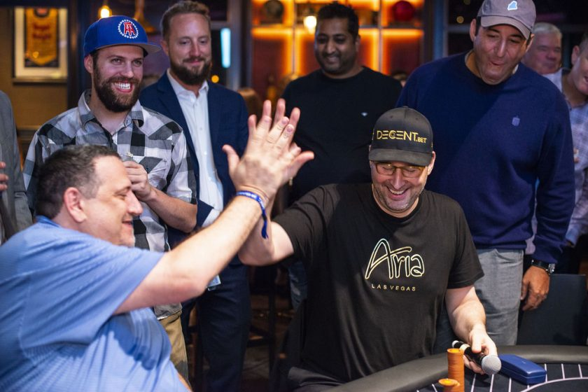 Stuart Porad and Phil Hellmuth celebrate during heads-up play